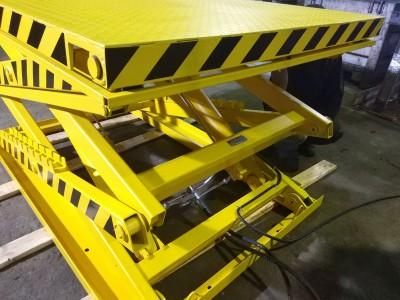 Особенности применения гидравлический подъемников для склада
